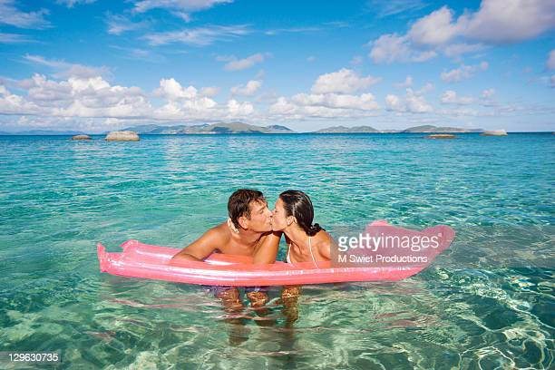 Couple kissing beach