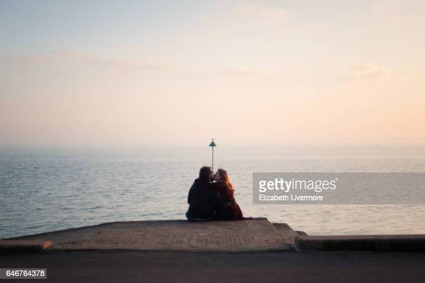 a couple kissing by the seaside - affectionate stock photos and pictures