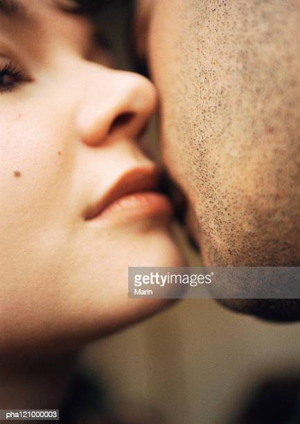 Couple kissing, close-up