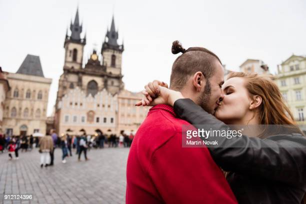 Couple kissing each other on their tour to Europe