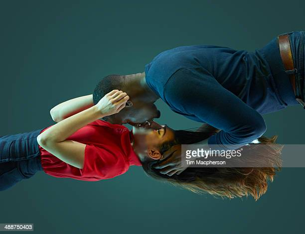 couple kissing, floating in mid air - kissing stock pictures, royalty-free photos & images