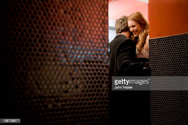 Couple kissing in bathroom