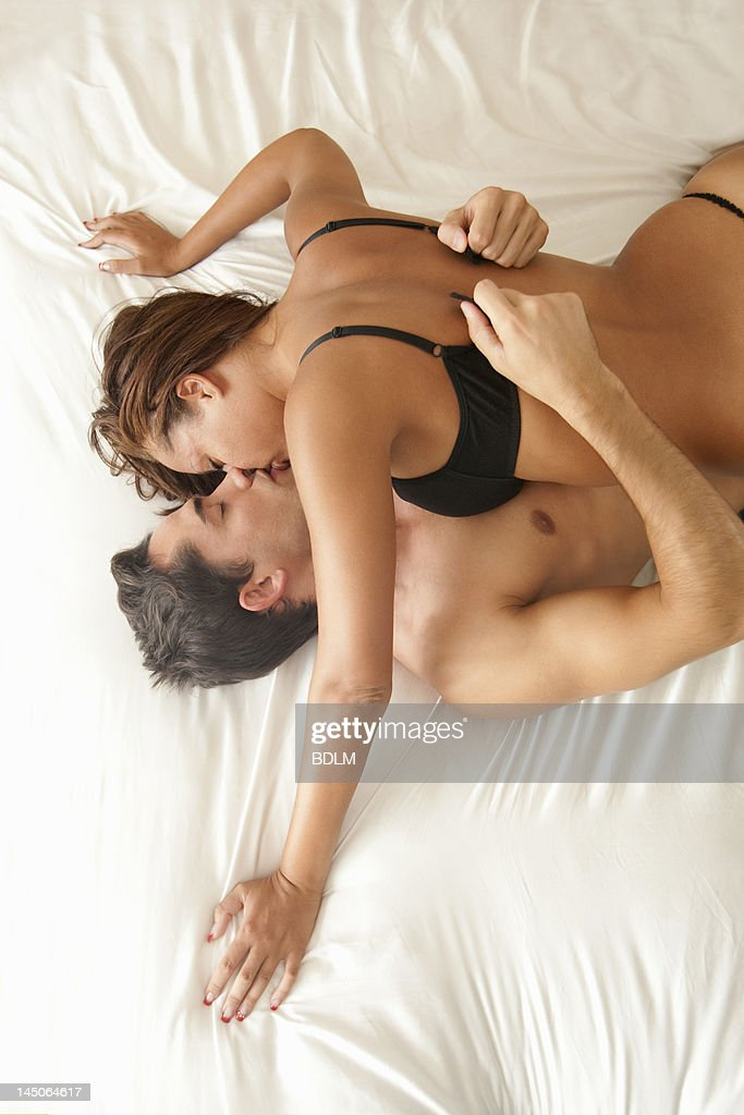 Couple Kissing In Bed High-Res Stock Photo - Getty Images-8156