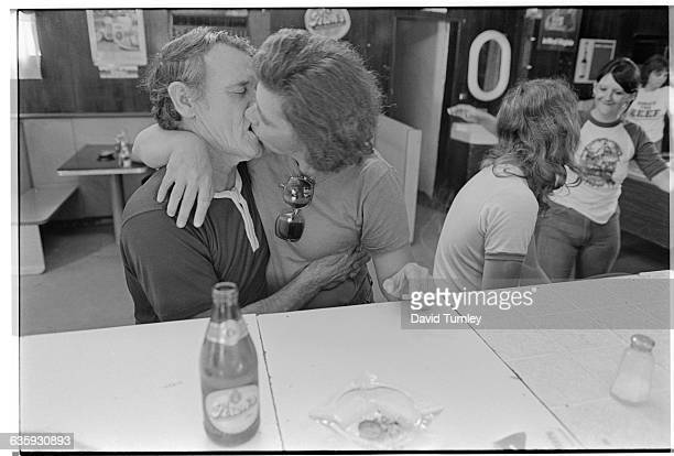 Couple Kissing in Diner