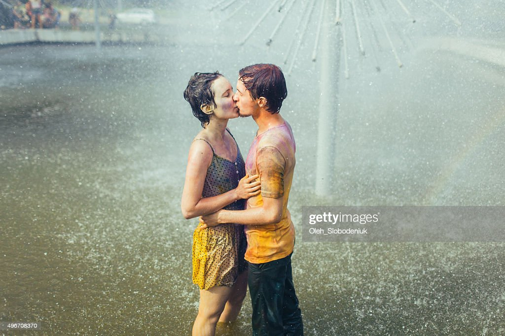 Couple kissing in fountain : Stock Photo