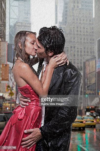 Couple kissing in rainstorm
