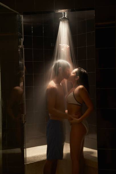 Couple kissing in spa shower