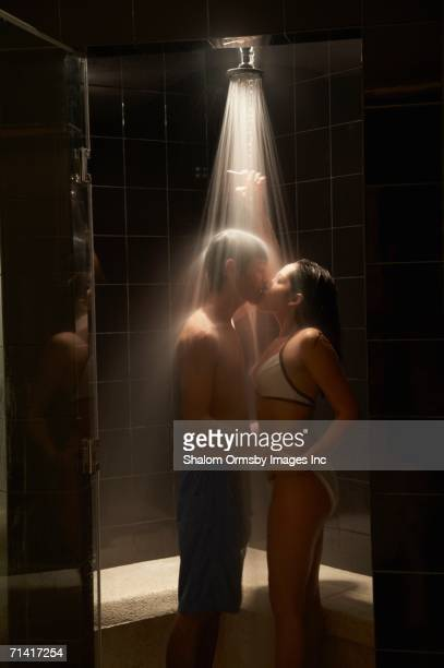 couple kissing in spa shower - couples showering stock pictures, royalty-free photos & images