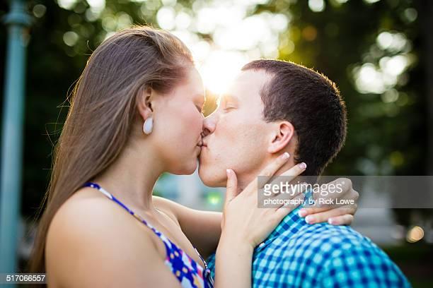 Couple kissing in sunlight BK