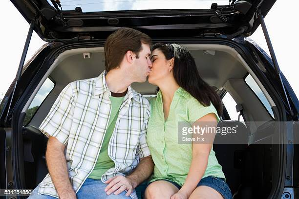 couple kissing in suv - leg kissing stock photos and pictures