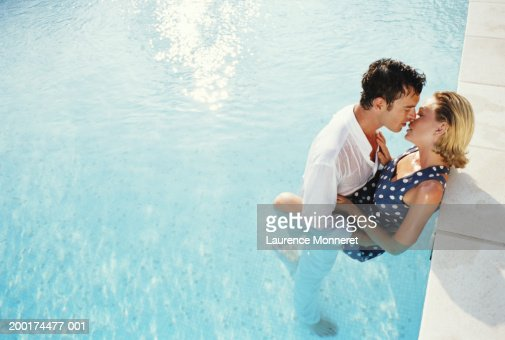Couple Kissing In Swimming Pool Fully Clothed Elevated View Stock Photo Getty Images