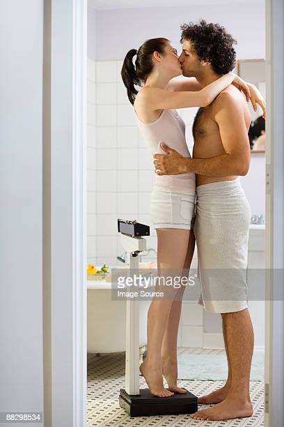 couple kissing in the bathroom - couple and kiss and bathroom stock photos and pictures