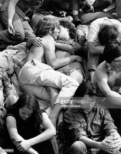 A couple kissing in the crowd at the Isle of Wight Pop Festival