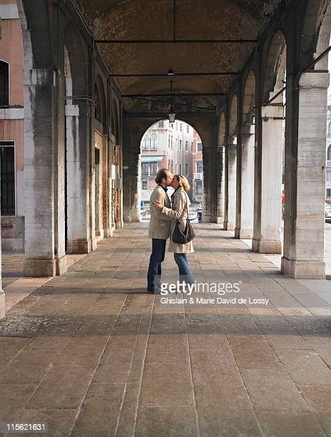 Couple kissing in venice, Italy