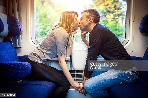 Couple kissing inside a train