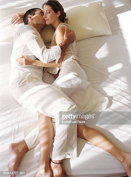 couple kissing on bed - girlfriend stock pictures, royalty-free photos & images