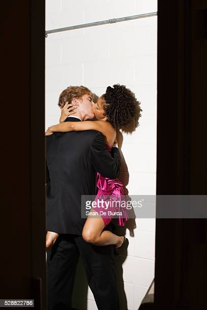 couple kissing on date - black women kissing white men stock pictures, royalty-free photos & images
