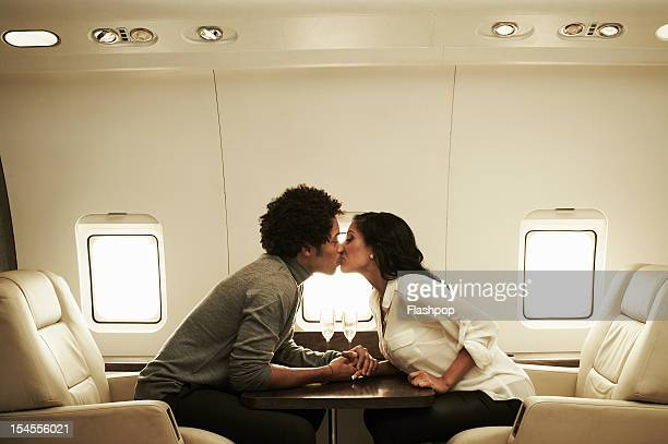Couple kissing on private jet