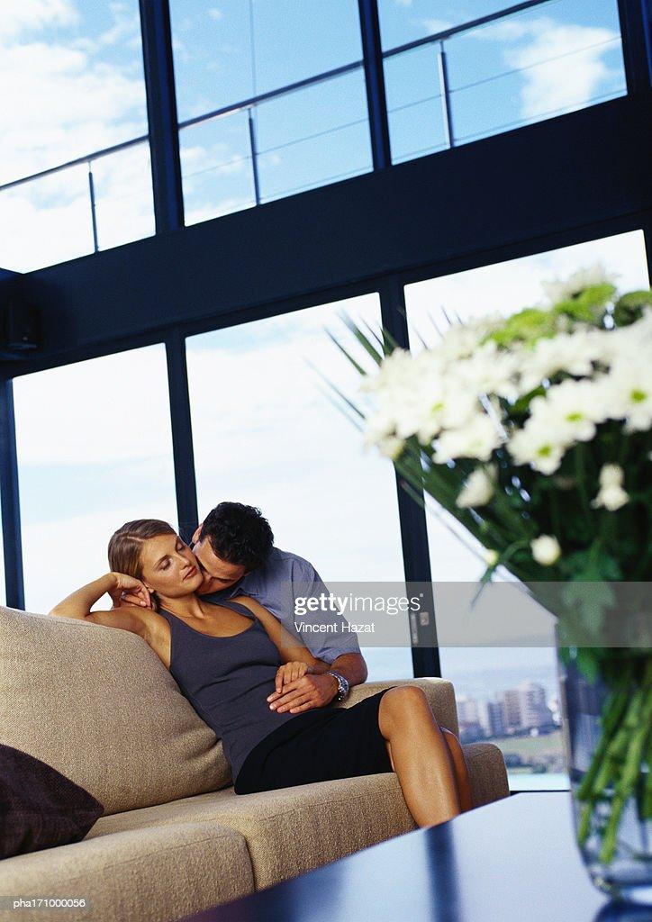 Couple kissing on sofa : Stockfoto