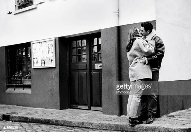 Couple kissing on street corner