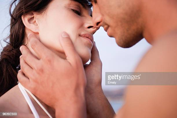 couple kissing on the beach