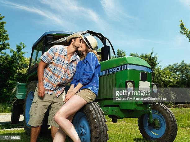 Couple kissing on tractor