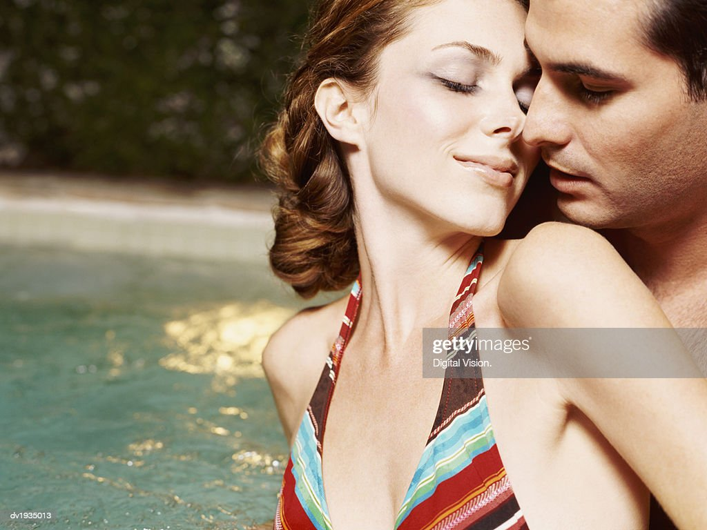 Couple Kissing Outdoors by a Jacuzzi : Stock Photo