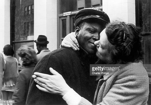 A couple kissing outside the 'Piss House' pub on the Portobello Road Notting Hill London 1968