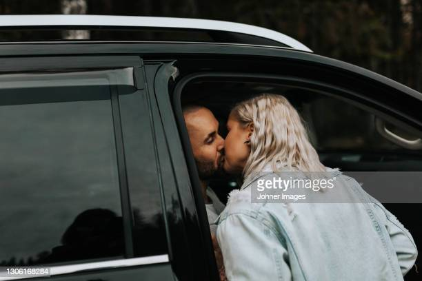 couple kissing - västra götaland county stock pictures, royalty-free photos & images