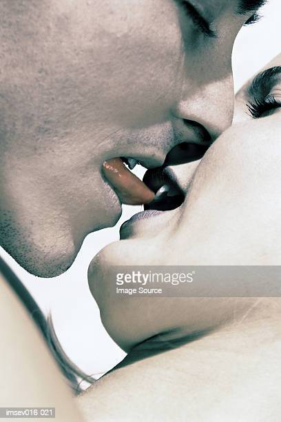 couple kissing - couple tongue kissing stock photos and pictures