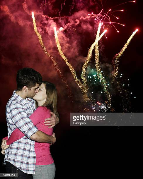 couple kissing under fireworks - kiss stock pictures, royalty-free photos & images