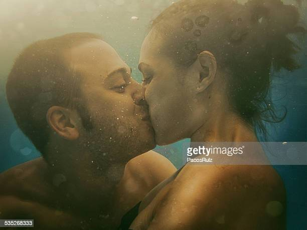 Couple kissing under the water
