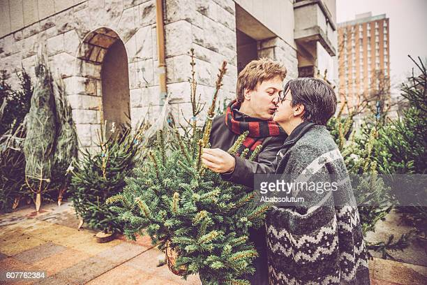 Couple Kissing while Choosing Christmas Tree, City Market, Europe