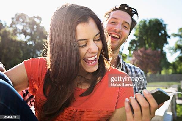 Couple laughing about something.