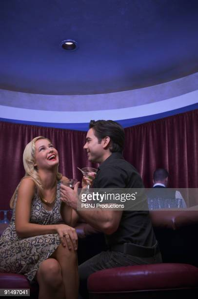 Couple laughing at nightclub