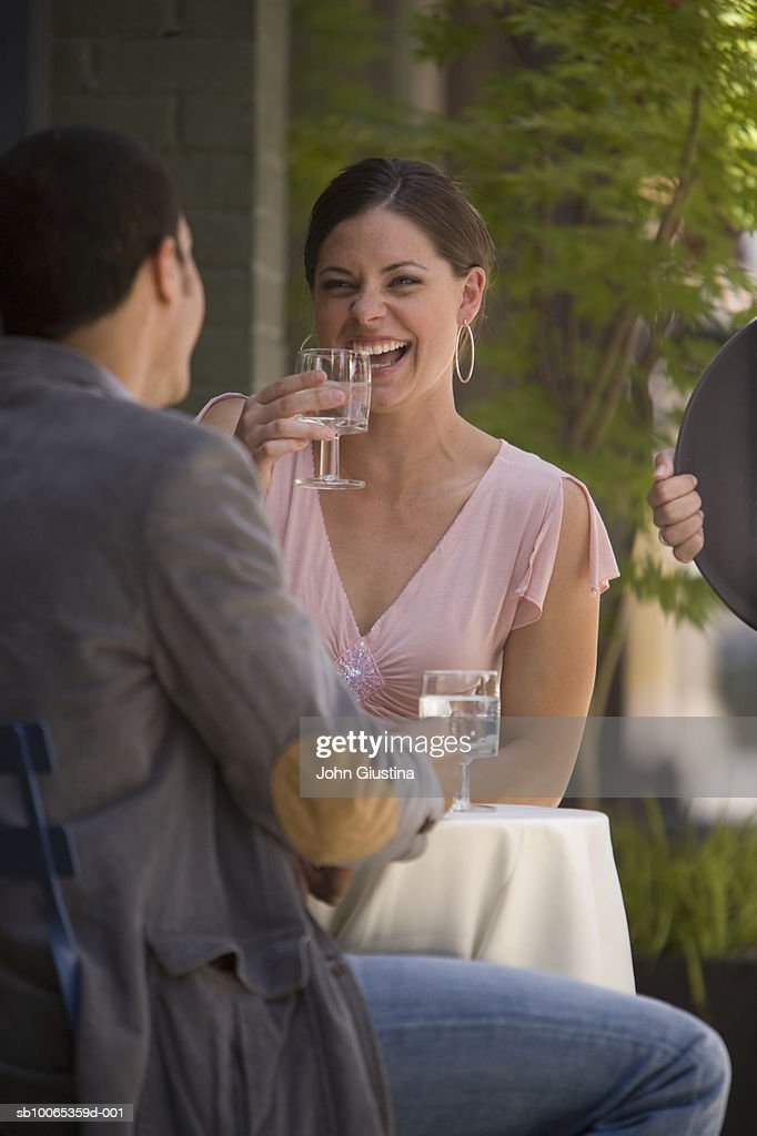 Couple laughing at outdoor cafe : Foto stock