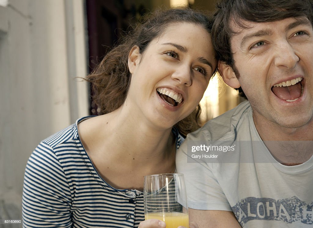 Couple laughing away from camera : Stock Photo