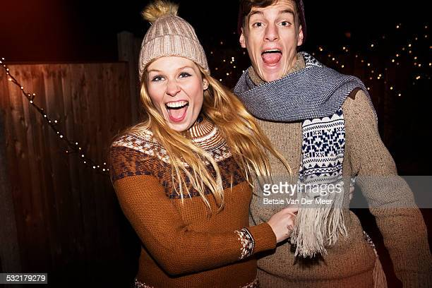 Couple laughing, dressed in winterclothes outdoors