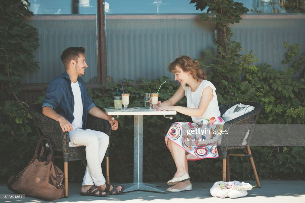 Couple laughing in cafe : Stock Photo
