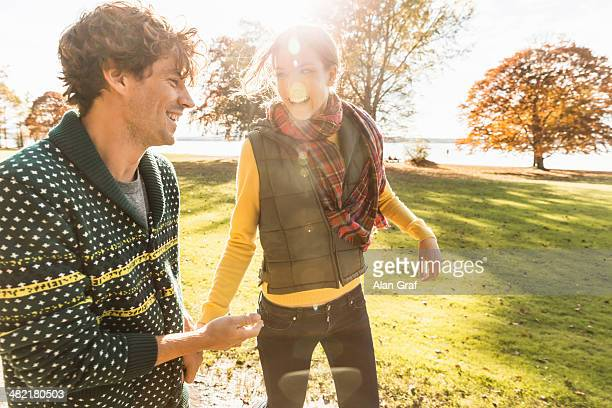 Couple laughing in sunlight in park