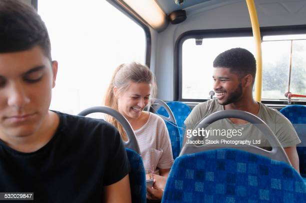 Couple laughing on bus