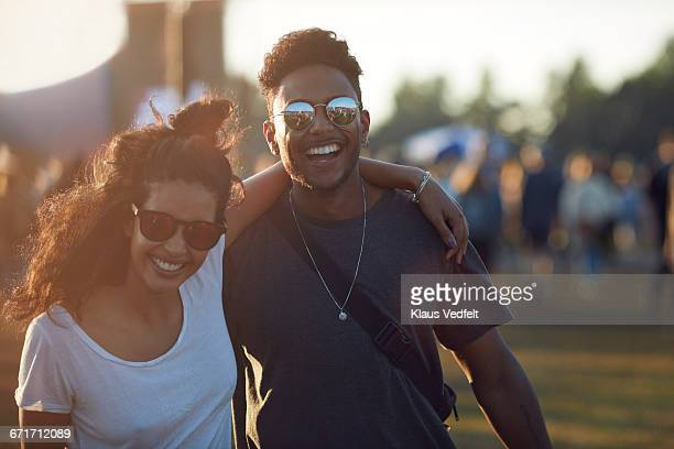 Couple laughing together at big festival