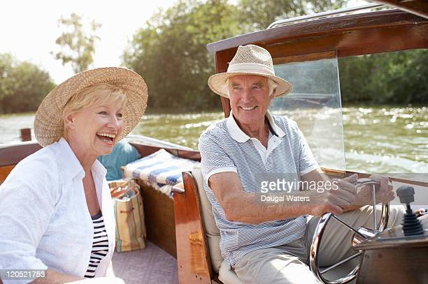 Couple laughing together in boat.