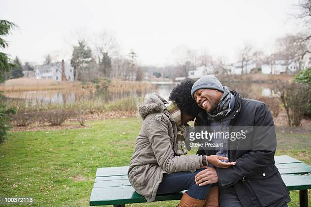 couple laughing together in park - stamford connecticut stock pictures, royalty-free photos & images