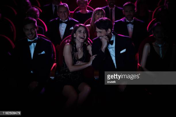 couple laughing while enjoying opera amidst crowd - entertainment event stock pictures, royalty-free photos & images