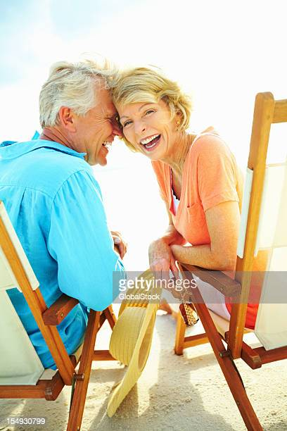 Couple laughing while enjoying the beach