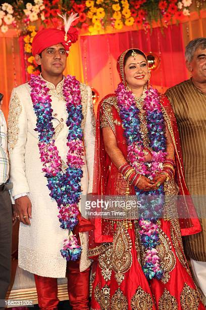 Couple Lawyer Ashok Basoya and ex Delhi University Student Union president Ragini Nayak pose during their Wedding ceremony on May 5 2013 in New Delhi...