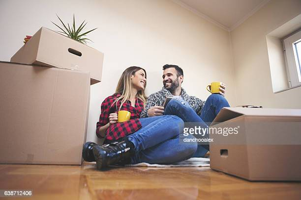 Couple laying on the floor of their new house