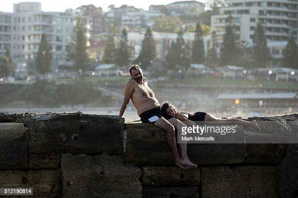A couple laze by a rock pool in Coogee on February 25 2016 in Sydney Australia The bureau of meteorology forecast temperatures over 40 degrees for...