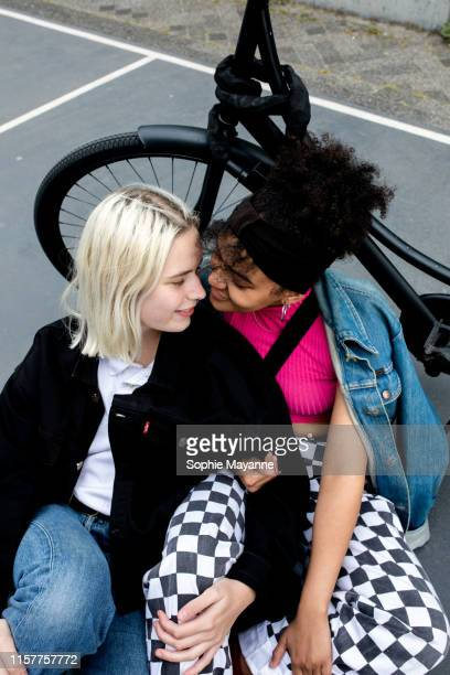 LGBT couple leaning in close